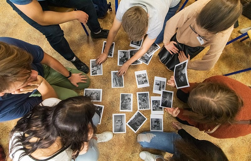 Group of young people sorting photos